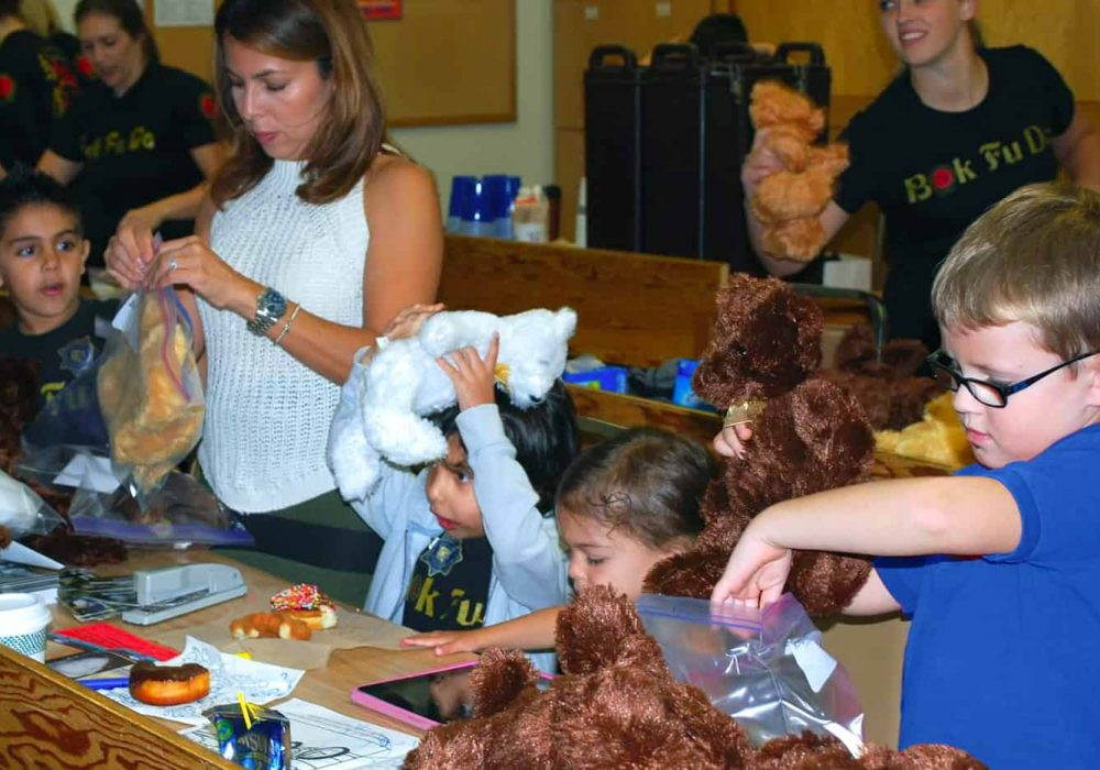 Children packing teddy bears